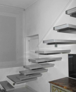 Suspended staircase and loft